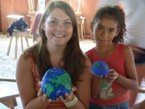 Volunteer Shannon and Melissa have the whole world in their hands!