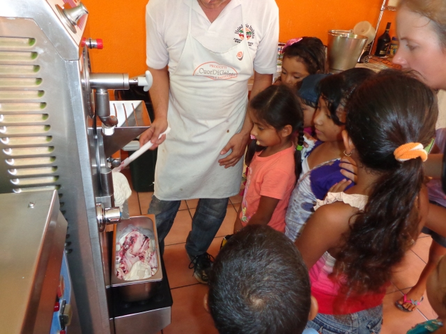 Leonardo showing the children how gelato is made
