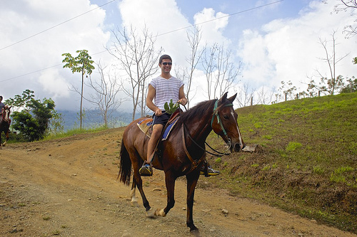 Samuel doing some horseback riding in San Isidro